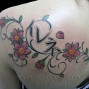 Tatuaje Flores y Kanjis
